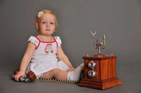 child and retro phone Stock Photo - 9381513