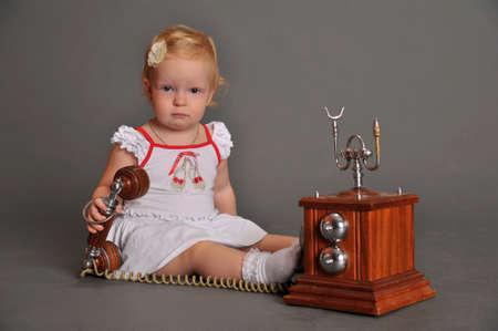 child and retro phone Stock Photo - 9381514