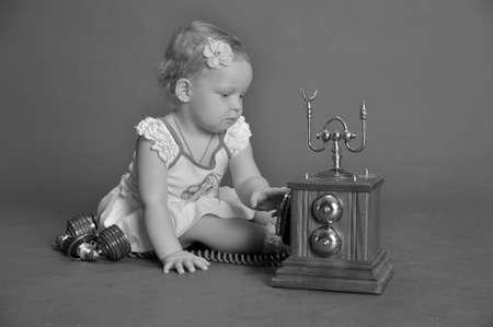 child and retro phone Stock Photo - 9381510