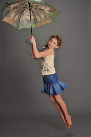 Girl with umbrella jumping photo