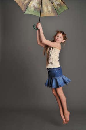 Girl with umbrella jumping Stock Photo - 9381493