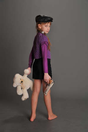 Little girl with big gun Stock Photo - 9445575