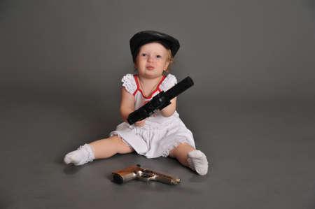 Danger - little girl with gun photo