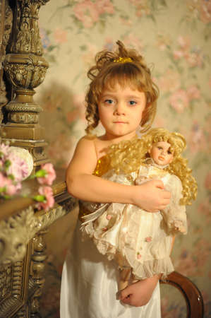 girl with a doll. Photo retro photo