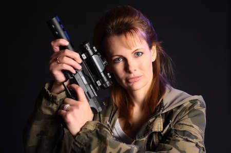 Young military gun woman Stock Photo - 9381542