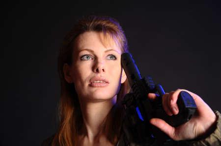 Young military gun woman Stock Photo - 9381530