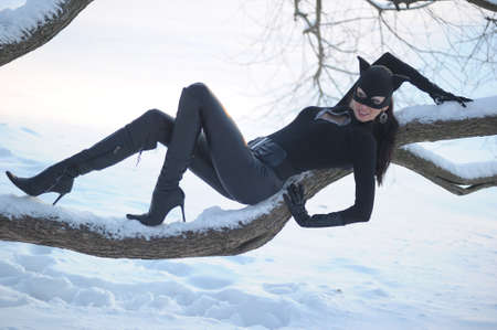 Woman wearing catsuit and mask photo