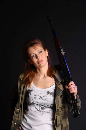 beautiful young woman with a gun Stock Photo - 10078957