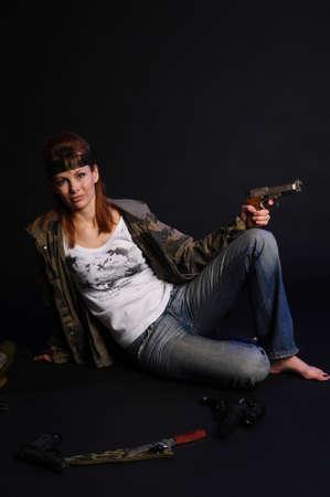 holding gun to head: beautiful young woman with a gun Stock Photo