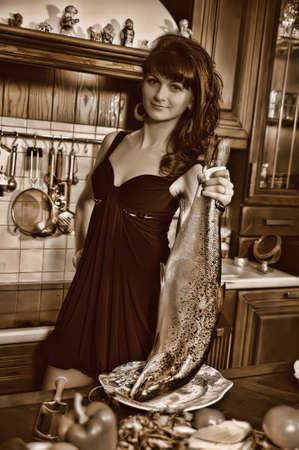 Housewife cleaning the fish photo