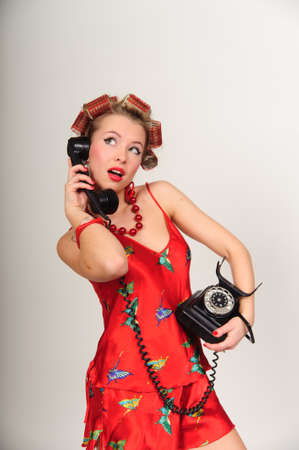 Girl in Pin up pose & Fashion talking on the phone Stock Photo - 9403787