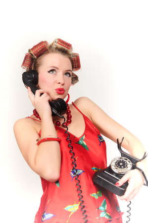 Girl in Pin up pose & Fashion talking on the phone Stock Photo - 9403794