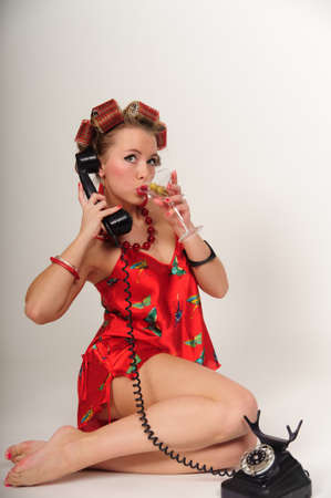 Girl in Pin up pose & Fashion talking on the phone Stock Photo - 9399407