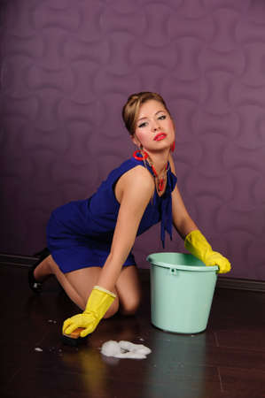 Sexy housewife is cleaning the floor Stock Photo - 9403788