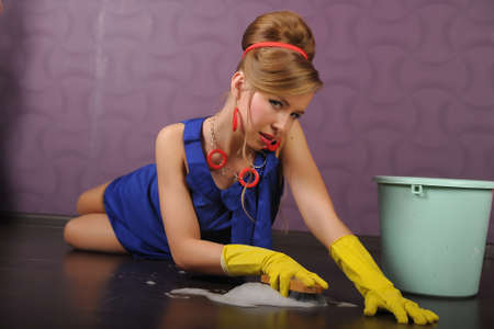 Sexy housewife is cleaning the floor photo