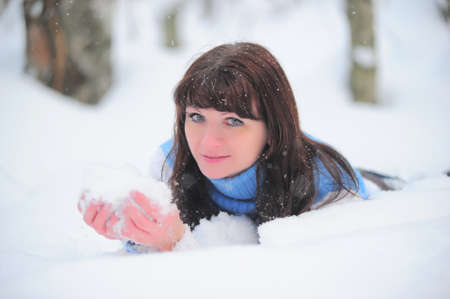 The young woman with snow in hands Stock Photo - 11957035
