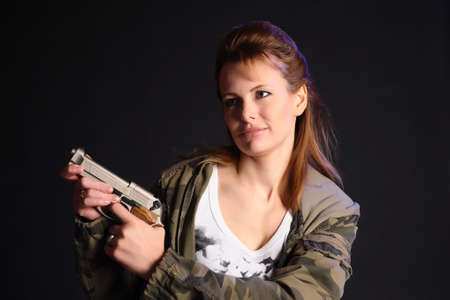 Portrait of the blonde with gun Stock Photo - 13306407