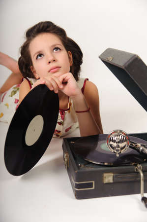 Girl with a gramophone and records photo
