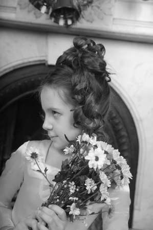 little princess with a bouquet of flowers photo