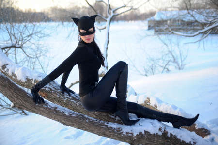 catsuit: Beautiful young woman wearing catsuit and mask