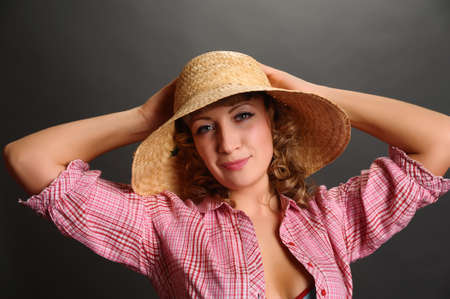 young woman in a straw hat photo