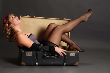 pin up girl in a suitcase photo