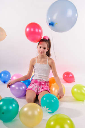 Girl and balloons photo