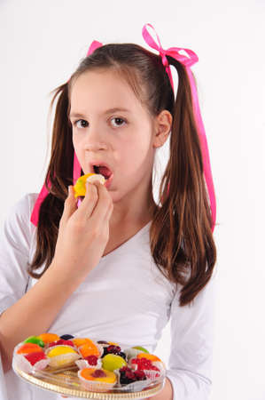 Girl eating cake photo