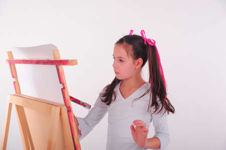 The girl drawing мо an easel photo