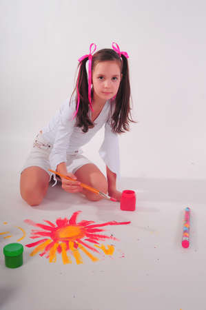 The girl drawing on a floor photo