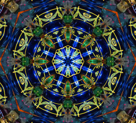 stained glass: blue and green circular pattern mandala