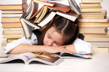 struggling: Girl student with books