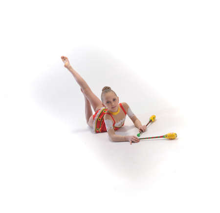 flexible woman: Girl gymnast with clubs