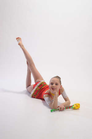 flexibility: Girl gymnast with clubs