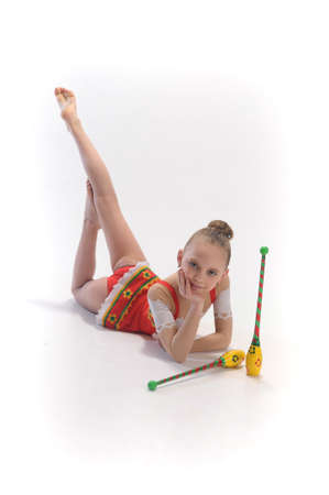 Girl gymnast with clubs Stock Photo - 9416186