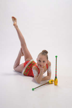 leotard: Girl gymnast with clubs