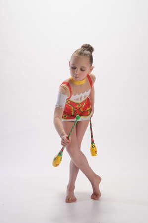 leotard: Girl gymnast with clubs