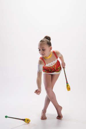 rhythmic gymnastic: Girl gymnast with clubs