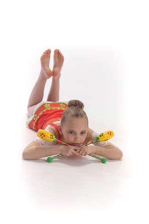 rhythmic gymnastics: Gimnasta de chica con clubes Foto de archivo