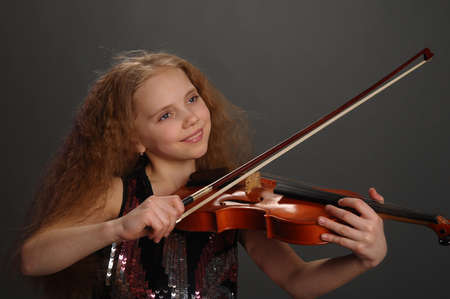 Girl with violin photo