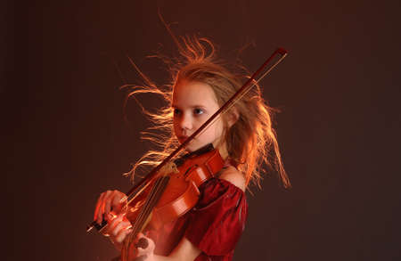 performing: Girl with violin