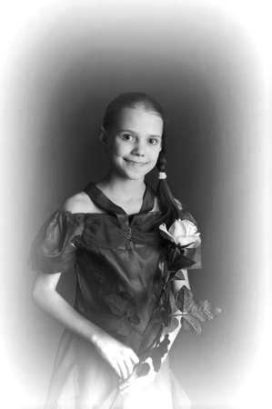 Beautiful child girl with  rose. photo