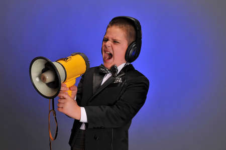 huffy: boy screaming at the loudspeaker Stock Photo