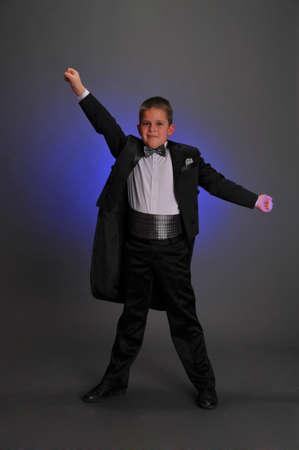 Boy wearing tuxedo photo