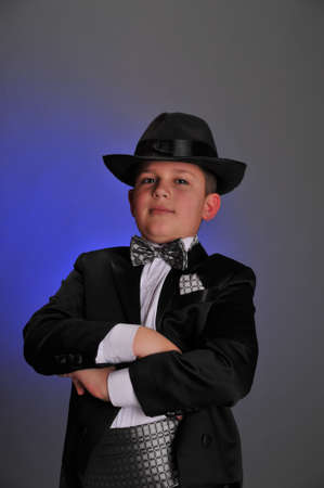 boy in a frock coat and hat photo