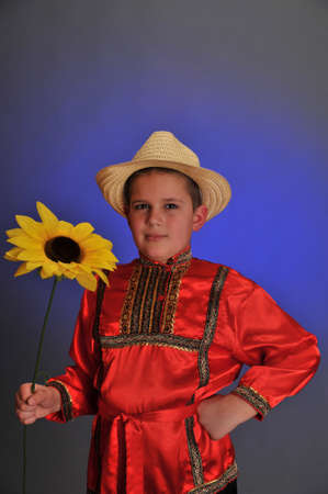 boy in the Russian folk shirt with sunflower photo