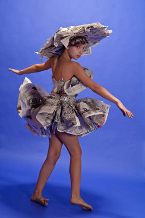 girl in a dress from newspapers photo