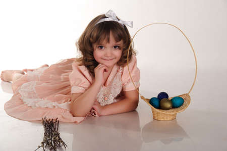 The little girl with easter eggs and willow photo