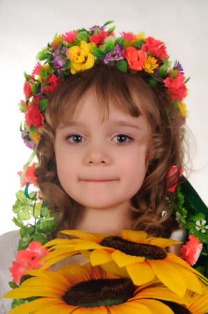 Ukrainian girl wreath and sunflower photo