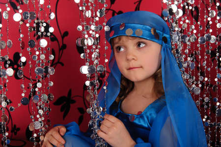 The little girl in oriental costume photo